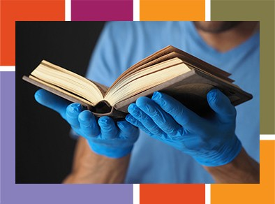 Graphic of gloved hands and library book.